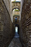 Stretch alleyway. Narrow alley of stone and bricks Stock Photography