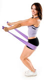 Stretch Band Yoga Work Out. Woman working out with stretch bands Royalty Free Stock Image
