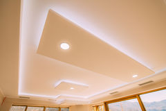 Stretch ceiling film. The design of the apartment. Renovated apa Royalty Free Stock Image