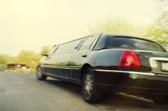 Stretch limo. Photo of stretch limo pulling away - motion blur Stock Image