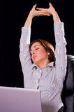 Stretch oneself. Young woman tired from work and want to sleep Stock Photos
