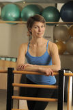Stretch on Pilates Barrel Royalty Free Stock Images
