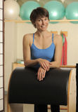 Stretch on Pilates Barrel Stock Photo