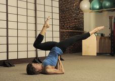 Stretch on Pilates Barrel Royalty Free Stock Photography
