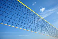 Stretched black valleyball net. Black valleyball net is stretch from corner to corner against deep blue sky Royalty Free Stock Photography