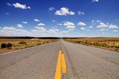 Stretched desert road Stock Photography