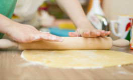 Stretched  Dough on the Kitchen Table Royalty Free Stock Photo