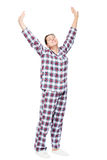 Stretched girl in pajamas on a white background Royalty Free Stock Photo