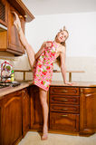 Stretched leg-split flexible beautiful young woman pinup blond girl with a lovely body drinking beverage Stock Photography