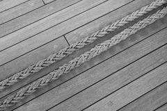 Stretched thick rope. Thick rope stretched over a deck of a ship Stock Photos