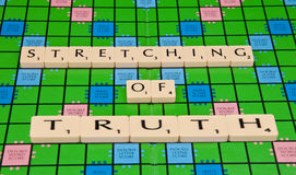 Stretched Truth. The truth being stretched out on a scrabble board royalty free stock photography
