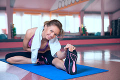 Stretches in fitness club Stock Photo