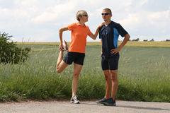 Stretching. A stretching man and woman Royalty Free Stock Photo