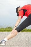 Stretching. Male runner strechting after a run Royalty Free Stock Photos