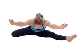 Stretching of adductors, ischio and quadriceps. Stretching pose executed with a professional trainer Stock Images