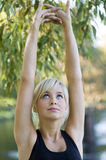 Stretching arms Royalty Free Stock Photography