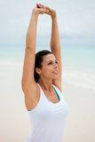 Stretching arms exercise for relaxing at the beach Stock Photos