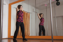 Stretching arms before pole dance Royalty Free Stock Images