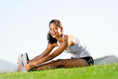 Stretching athlete Royalty Free Stock Image