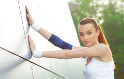 Stretching athlete female warming up Royalty Free Stock Images