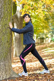 Stretching in autumn park royalty free stock images