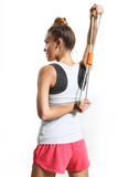 Stretching back muscles. Athletic woman stretching back muscles training with rubber royalty free stock photos