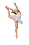 Stretching ballerina. Young ballerina stretching upwards on a white background Royalty Free Stock Photos
