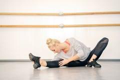 Stretching ballerina stock image