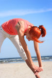 Stretching on beach Stock Photography