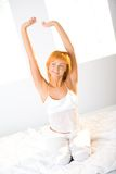 Stretching on bed Stock Images