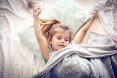 Stretching in bed. royalty free stock images