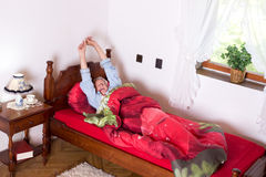Stretching in bed Royalty Free Stock Photos