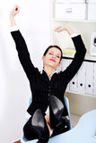 Stretching businesswoman. Stock Image