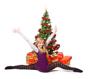 Stretching beside a Christmas tree Royalty Free Stock Image