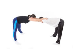 Stretching in couple Royalty Free Stock Photos
