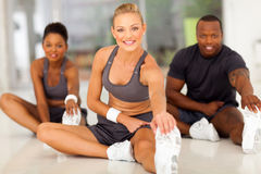 Stretching before exercise. Beautiful young women stretching before exercise Royalty Free Stock Photography