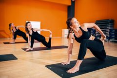 Female yoga group, training with instructor royalty free stock photos