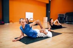 Female yoga group, training with instructor Royalty Free Stock Image