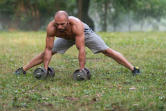 Stretching Exercise Outdoors Workout With Dumbbells Stock Photography