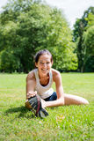 Stretching exercise - sport woman outdoor Stock Photography
