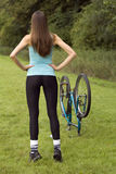 Stretching exercises. Active woman doing stretching exercises outdoor Royalty Free Stock Photo