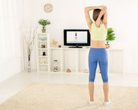 Stretching Exercises Along With TV Stock Image