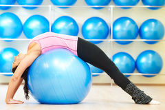 Stretching exercises with fitness ball Royalty Free Stock Image