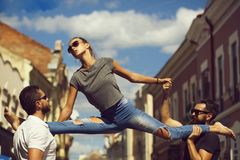 Stretching exercises, friends and relationship, dominance and matriarchy. Stretching exercises, gymnastics, sport, active lifestyle, summer activity, beauty and royalty free stock photo