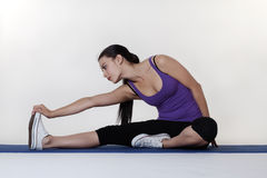 Stretching exercises on a mat Stock Image