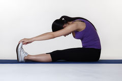 Stretching exercises on a mat Royalty Free Stock Photography