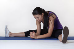 Stretching exercises on a mat Royalty Free Stock Image