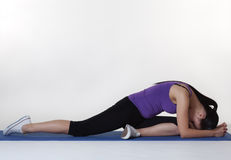 Stretching exercises on a mat Royalty Free Stock Photo