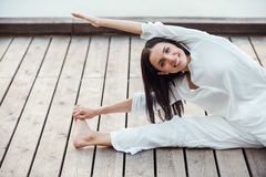 Stretching exercises outdoors. Royalty Free Stock Photo