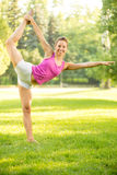 Stretching Exercises In The Park Royalty Free Stock Photography